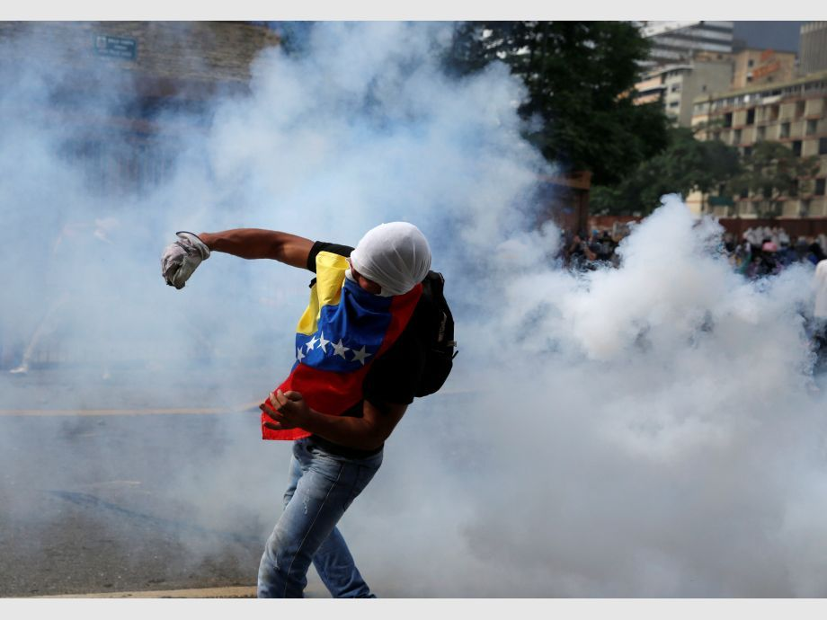 Opposition demonstrators clash with riot police during the so called