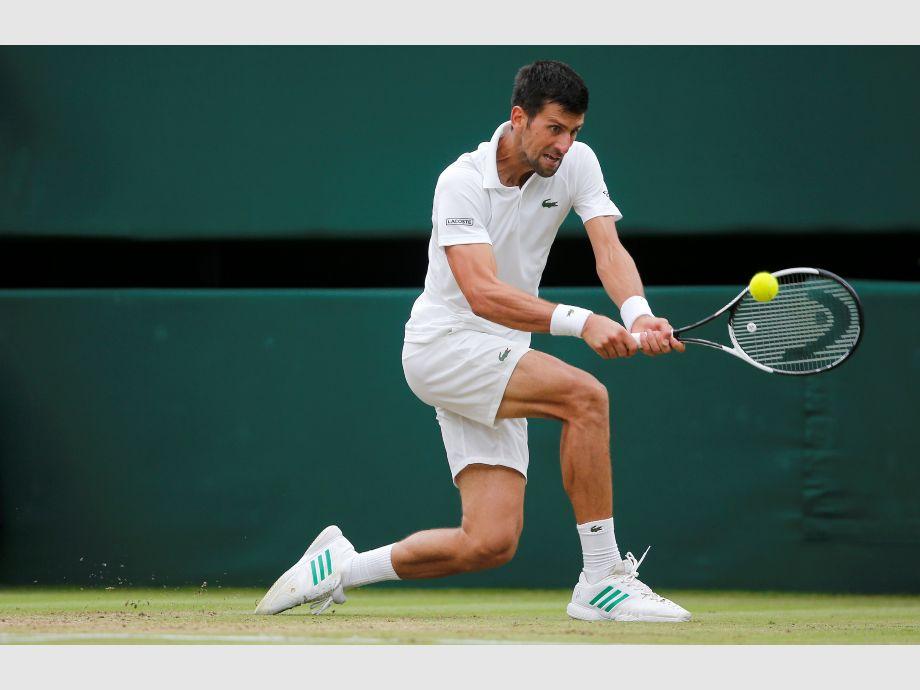 Federer arrasa a Dimitrov y Murray a Paire en Wimbledon