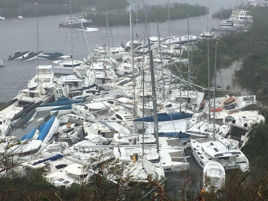 Pleasure craft lie crammed against the shore in Paraquita Bay after Hurricane Irma passed Tortola - 3TP NARCH/NARCH30 MNDTY SALESOUT - Huracán Irma