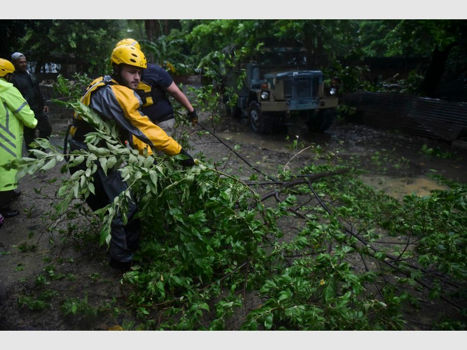Joshua Alicea, rescue staff member from the Municipal Emergency Management Agency removes a fallen tree while touring the streets of the Matelnillo community searching for citizens in distress during the passage of Hurricane Irma through the northeastern part of the island in Fajardo, Puerto Rico, Wednesday, Sept. 6, 2017. The US territory was first to declare a state of emergency las Monday, as the National Hurricane Center forecast that the storm would strike the Island Wednesday. (AP Photo/Carlos Giusti) - PUERTO RICO OUT-NO PUBLICAR EN PUERTO RICO - Huracán Irma