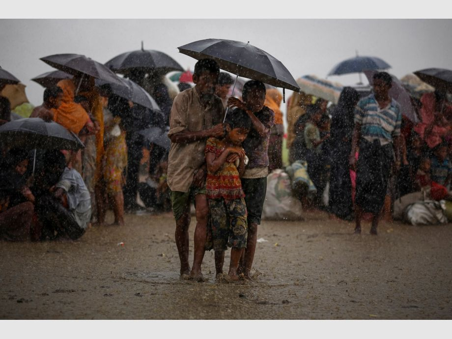 AWARD WINNER: Pulitzer for Feature Photography - Rohingya refugees try to take shelter from torrential rain as they are held by the Border Guard Bangladesh (BGB) after illegally crossing the border, in Teknaf, Bangladesh, August 31, 2017. REUTERS/Mohammad Ponir Hossain  TO FIND ALL PICTURES SEARCH REUTERS PULITZER -