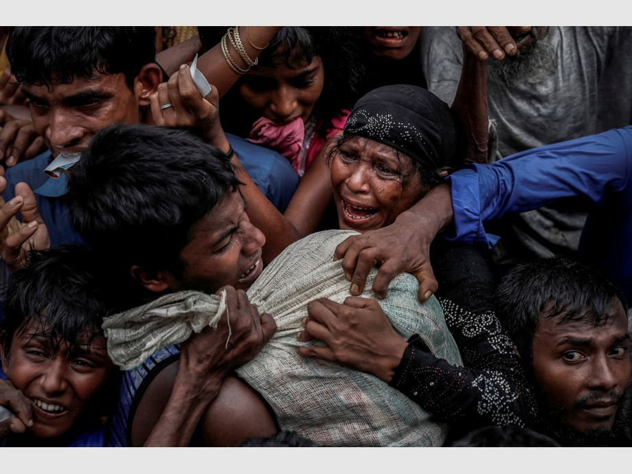AWARD WINNER: Pulitzer for Feature Photography - Rohingya refugees scramble for aid at a camp in Cox -