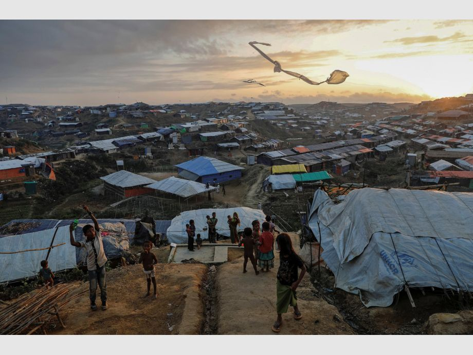 AWARD WINNER: Pulitzer for Feature Photography - Rohingya refugee children fly improvised kites at the Kutupalong refugee camp near Cox -