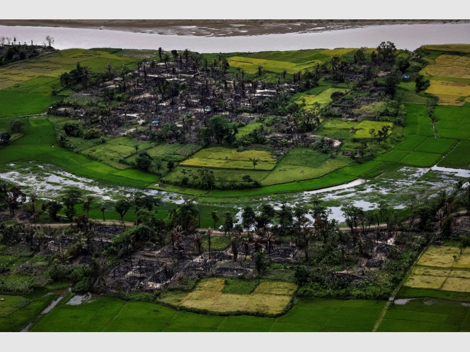 AWARD WINNER: Pulitzer for Feature Photography - The remains of a burned Rohingya village is seen in this aerial photograph near Maungdaw, north of Rakhine State, Myanmar September 27, 2017. REUTERS/Soe Zeya Tun      TO FIND ALL PICTURES SEARCH REUTERS PULITZER -
