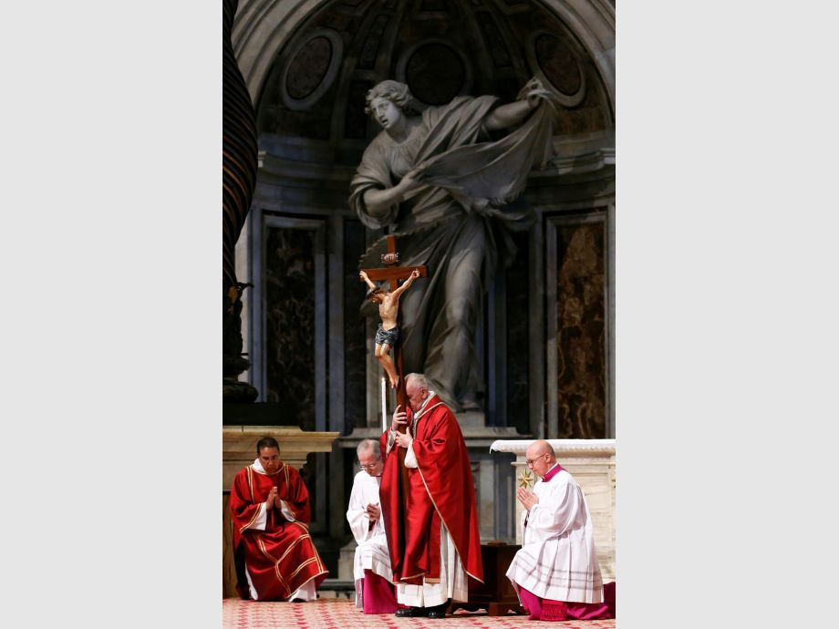 Pope Francis leads the Good Friday Passion of the Lord service in Saint Peter -