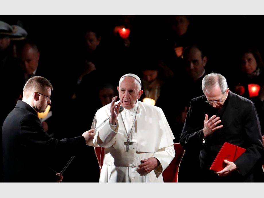 Pope Francis leads the Via Crucis procession at Rome -