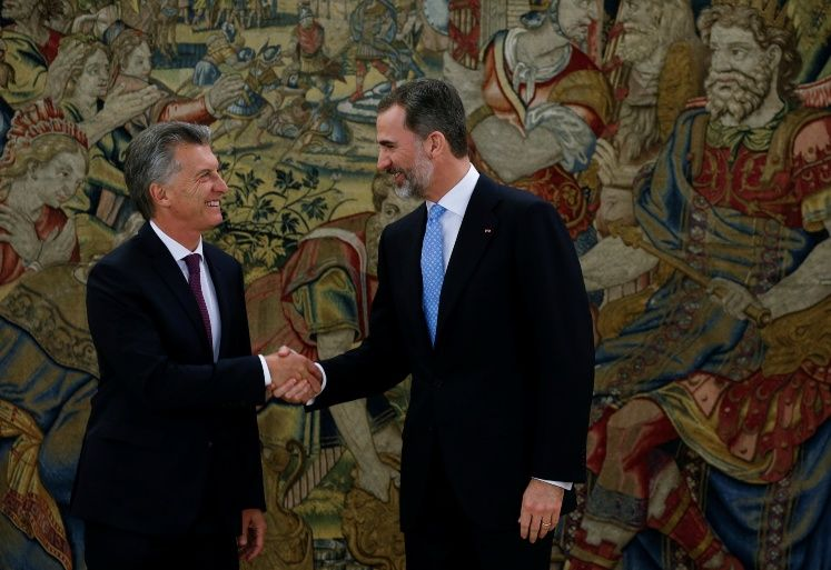 Spain's King Felipe and Argentina's President Macri shake hands before their lunch at the Zarzuela Palace in Madrid
