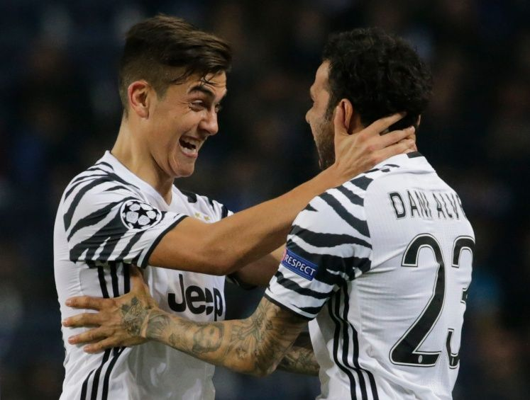 Juventus' Dani Alves celebrates scoring their second goal with Paulo Dybala - 17-CCT51731