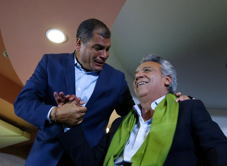Ecuadorean presidential candidate Lenin Moreno is greated by Ecuador's President Rafael Correa while waiting for the results of the national election in a hotel, in Quito